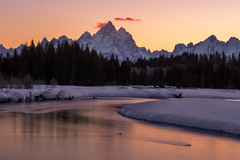 A Grand Sunset (NickSouvall) Tags: grand teton national park wyoming southwest united states orange pink warm color sky colorful clouds sunset light glow haze peaks mountains range snow ice frozen landscape scenery winter photography nature long exposure