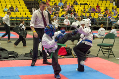 Action from the Karate Mats (aaronrhawkins) Tags: karate kick mat tournament spar fight martialarts boy children kids match ring uvu utah orem joshua action offense aaronhawkins