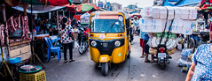 2019 - Cambodia - Sihanoukville - Phsar Leu Market - 5 of 25 (Ted's photos - Returns late November) Tags: 2019 cambodia cropped nikon nikond750 nikonfx tedmcgrath tedsphotos vignetting wideangle streetscene street peopleandpaths pathsandpeople motorcycle tuktuk ossapp yellow phsarleumarket phsarleumarketsihanoukville sihanoukvillephsarleumarket sihanoukville sihanoukvillecambodia meat market
