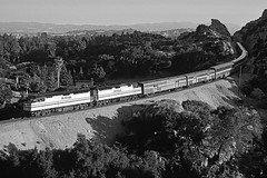 rr64-14m bw (George Hamlin) Tags: california santa susanna pass chatsworth rocks railroad passenger train amtrak atk coast starlight eastbound 11 emd f40ph diesel locomotives baggage cars superliners trees mountains fill signal monochrome black white photo decor george hamlin photography