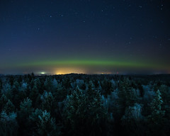 New Years' Eve (Jurgis Kreilis) Tags: green aurora auroraborealis new year winter winterwonder above trees forest tower light north northernlights panorama wintermood