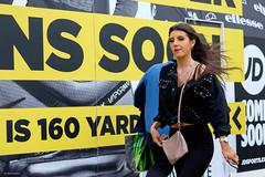 160 Yard Dash (Silver Machine) Tags: portsmouth hampshire streetphotography street candid candideyecontact jdsports girl walking billboard shopfront fujifilm fujifilmxt10 fujinonxf35mmf2rwr