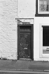 Door (bigalid) Tags: film 35mm vivitar mega 200 ilford xp2 c41 bw april 2019 scotland castledouglas door