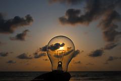 ILLUMINATING THE WORLD FOR THE PAST 4.6 BILLION YEARS ! (GOPAN G. NAIR [ GOPS Creativ ]) Tags: gopsorg gopangnair gops gopan gopsphotography creativ photography bulb light sun sky sea ocean cloud heavenly sunset electricity tungsten filament lamp illuminate