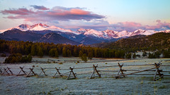 Panorama View of Longs Peak  and Rocky Mountain National Park (RondaKimbrow) Tags: longs peak mountain sunrise range pasture trees light colorful estes park colorado pano panorama view scenic travel tourism peaks landscape panoramic sky summit nature rocky mountains snowcapped split rail fence beautiful morning dawn clouds no one outside scene eos r
