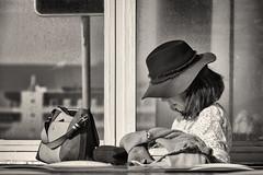 'Reading Break' (Canadapt) Tags: woman reading purse hat profile bw toned praiagrande portugal canadapt