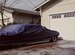 Sunnyvale, California (bior) Tags: pentax645nii pentax645 6x45cm ektachrome e200 kodakektachrome slidefilm mediumformat 120 sunnyvale street rain suburbs car driveway garage