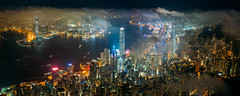 Panorama aerial view of Hong Kong City skyline at night over the clouds (MongkolChuewong) Tags: above aerial aerialview architecture asia asian blue building buildings business china city cityscape cloud district downtown drone dusk evening flying harbor harbour hong hongkong kong landmark landscape light metropolis modern mountain night office panorama peak peaks scene sea sky skyline skyscraper sunrise sunset topview travel urban victoria victoriapeak view
