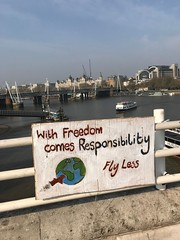 With freedom comes responsibility. Fly less (Matt From London) Tags: extinctionrebellion protest london poster flying environment thames