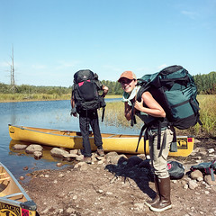 Portage Packing (Aaron Bieleck) Tags: 120film analog 6x6 square film filmisnotdead hasselblad mediumformat wlvf kodakportra160 friends boundarywaters minnesota mn canoe outdoors 60mmct people piragis portage