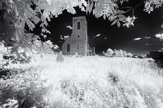 Ghostly churchyard (David Feuerhelm) Tags: monochrome mono blackandwhite bw noiretblanc schwarzundweiss blancoynegro contrast infrared ir wideangle ethereal ghostly chruch churchyard tower building leaves frame grass grave sky nikon d90 silverefex sigma1020mmf456 suffolk