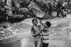Monsoon Run (A. adnan) Tags: samyang sony bangladesh chittagong run monsoon rainy umbrella street siblings children streetphotography samyang35mm sister brother