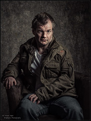 A Portrait of Stuart (trevager) Tags: ad200 ad600 brightpixphotography chaircopyrighttrevorager fashion flash godox grungy jacket male man model modelstuartmodel modellingphotographersgroup portrait seated spikyhair springwoodcomminitycentre strobes texture