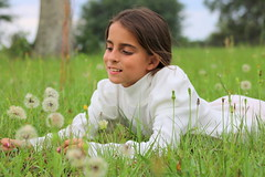 She is the dandelion in my life (chrisivuk) Tags: sister dandelions girlwithdandelions spring lyinginthegrass canon