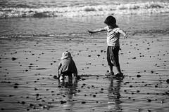 Siblings (mgschiavon) Tags: blackandwhite blackwhite bw beach california people outdoors reflections