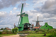 Windmills of Zaanse Schans (Brett of Binnshire) Tags: manipulations historicalsite on1raw zaandam netherlands museum zaanseschans locationrecorded northholland river water clouds architecture windmill weather