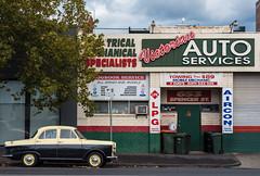 West Melbourne (Westographer) Tags: westmelbourne melbourne australia westernsuburbs suburbia australiansuburbia morrismajor parked signage signs typography carrepairs garage twotonemorrismajor autumnlight