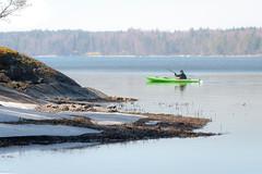 Green kayak (Mikael Neiberg) Tags: canoe shore sea seashore finland finnishnature leisuretime leisure water sunny snow spring helsinki vuosaari kallahti nikond700 nikkoraf75300mmf4556 landscape kayak