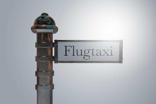 Flugtaxi-auf-Wegweiser-Schild