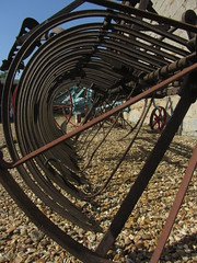 Tunnel of teeth (shaggy359) Tags: denny abbey cambridgeshire cambs museum bamfords tripaction rake agriculture agricultural machine machinery circle tunnel tube teeth through gravel