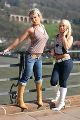 Janet & Mandy 03 (The Booted Cat) Tags: sexy long blonde hair girl girls girlgirl sister sisters tight blue jeans denim boots heels highheels belt