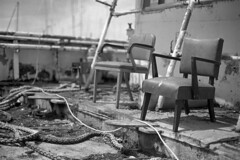 Captain's Chairs (macromary) Tags: rvarcticdiscoverer analog florida foma fomapan fomapan100 blackwhite analogphotograph bw blackandwhitefilm filmcamera film mechanicalcamera vintage vintagecamera rodinal 35mm nikkor 50mm 50mmlens 35mmfilm murbex abandoned putnamcounty urbex flurbex rurex derelict f14 nikonf100 f100 nikon ship asbestosremoval artificialreef floridayouthmaritimetraining chairs