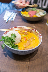 Yellow coconut tofu curry as vegan Asian lunch with Jasmin fragrant rice and baby spinach, in a traditional bowl with chopsticks, on a wooden table (verchmarco) Tags: food lebensmittel lunch mittagessen vegetable gemüse dinner abendessen dish gericht meal mahlzeit noperson keineperson bowl schüssel cooking kochen meat fleisch plate teller delicious köstlich grow wachsen cuisine traditional traditionell nutrition ernährung healthy gesund table tabelle homemade hausgemacht rice reis2019 2020 2021 2022 2023 2024 2025 2026 2027 2028 2029 2030 harbour truck interior windows historic ciel outside owl españa shop