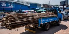 2019 - Cambodia - Sihanoukville - Phsar Leu Market - 22 of 25 (Ted's photos - Returns late November) Tags: 2019 cambodia cropped nikon nikond750 nikonfx tedmcgrath tedsphotos vignetting streetscene street truck poles shadow wheels phsarleumarket phsarleumarketsihanoukville sihanoukville sihanoukvillecambodia