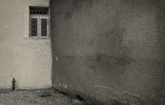 urban landscape - 46 (Rino Alessandrini) Tags: blackandwhite architecture old wallbuildingfeature dirty nopeople buildingexterior abandoned street house architectureandbuildings outdoors dark builtstructure urbanscene window weathered backgrounds oldfashioned damaged