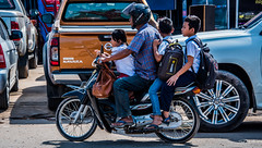 2019 - Cambodia - Sihanoukville - Phsar Leu Market - 25 of 25 (Ted's photos - Returns late November) Tags: 2019 cambodia cropped nikon nikond750 nikonfx tedmcgrath tedsphotos vignetting motorcycle streetscene street backpack helmut wheels phsarleumarket phsarleumarketsihanoukville sihanoukville sihanoukvillecambodia