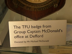 RAF Defford Museum at Croome - The TFU badge from Group Captain McDonald's office at Defford (ell brown) Tags: croome worcestershire england unitedkingdom greatbritain nationaltrust croomedabitot croomeestatetrust croomepark pershore lancelotcapabilitybrown 6thearlofcoventry rafdefford rafdeffordmuseum sign coatofarms shield thetfubadgefromgroupcaptainmcdonaldsofficeatdefford royalairforcetelecommunicationsflyingunit