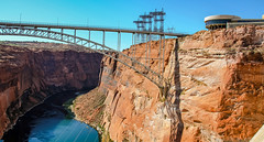 View of the Glen Canyon Bridge and Colorado River from Glen Canyon Dam (lhboudreau) Tags: glencanyondam bridge glencanyon page arizona pagearizona colorado river coloradoriver gorge canyon carlhaydenvisitorcenter visitor visitors center carlhayden rock rocky cliff power tower outdoor outdoors sky building powerlines