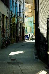 Alley Cats (Nick Upton_CFF) Tags: antwerp belgium flanders holiday vacation colour high contrast alley street people candid sony rx100 compact camera