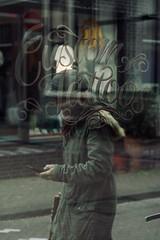 Everygrey the same (claudia 222) Tags: amsterdam streetphotography window noctilux human 50mm manualfocus glass writing grey