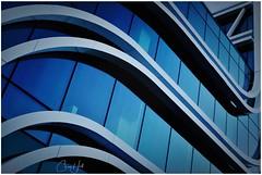 Curvy (cjhall.nz) Tags: fujifilmx100f newzealand modern curves reflections blue architecture auckland newmarket building mercuryenergy