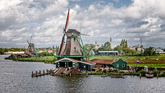 Lumber Windmill (Brett of Binnshire) Tags: historicalsite zaandam netherlands manipulations river locationrecorded water on1raw architecture windmill clouds weather museum zaanseschans northholland