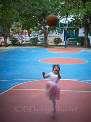 4-6 Yr Old Basketball English Lesson 40 (ArdieBeaPhotography) Tags: boy girl child kids children kindergarten preschooler elementary school age play basketball shoot throw catch pass toss ball leap jump tights white rainbow gauzy skirts trousers shorts shirt tshirt blue glasses court trees shadow leaves tummy navel button bare exposed sandals trainers shoes trackpants outside class learning teaching englishlesson black hair cute pretty beautiful handsome enthusiastic game energetic excited together tamronspaf2875mmf28xrdildasphericalif