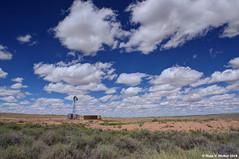 Waterhole (walkerross42) Tags: windmill waterhole desert plains desolate lonely arizona clouds water solarpanel sky