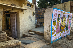 Hiding Mona Lisa (shapeshift) Tags: in alley alleyways asia davidpham davidphamsf documentary handpainted india jaisalmer moped motorcycle mural people rajasthan shapeshift sign southasia street streetart streetphotography travel nikon d5600 nikond5600