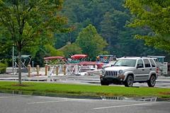Marina Jeep (NC Mountain Man) Tags: kj jeep liberty rockymountainedition 2004 boats parkinglot car trees grass lakelure ncmountainman nikon d70s phixe lowresolutionversion reflections