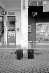 Dichotomy (Dani Irwan) Tags: 35mm film olympusmjuii olympusstylusepic aristapremium400 ilfordid11 blackandwhite noiretblanc blancoynegro 135 compact pointandshoot malaysia dustbins rubbishbins bins wastebins monochrome canoncanoscan8800f
