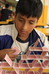 Pyramid Builder (klauslang99) Tags: klauslang streetphotography boy person cards pyramid playing concentration cuenca ecuador