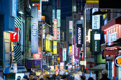Myeongdong Street Signs (Scintt) Tags: sky dramatic travel tourist attraction exploration movement skyline cityscape city urban modern architecture buildings scintillation scintt jonchiangphotography iconic surreal epic still glow light tones dusk twilight reflection lowangle korea evening blue hour sony a7rii seoul dongdaemun plaza abstract futuristic night clear steel structure metal concrete lines textures myeongdong street shopping signs billboards signboards tourism traffic brands logos people telephoto cluttered messy