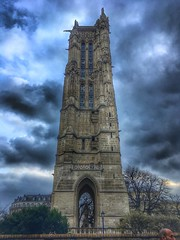 Paris France - Saint-Jacques Tower - Tour Saint-Jacques - Flamboyant Gothic Tower i (Onasill ~ Bill Badzo) Tags: destroyed church st jacques la boucherie is now considered national historic landmark remains métro station châtelet monument sly clouds photography paris france onasill atractionsite tourist travel ruederivoli flamboyant gothic tower frenchrevolution sunset sky iphone remainschurch pinnacle sculpture by paul chenillon