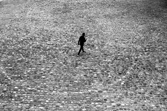 In the midst of stones (pascalcolin1) Tags: paris13 homme man pavés pavement pierres stones milieu midst middle photoderue streetview urbanarte noiretblanc blackandwhite photopascalcolin 50mm canon50mm canon
