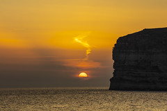 Dipping behind the clouds (CraDorPhoto) Tags: canon5dsr landscape sea mediterranean sun sunset golden cliffs slihouette nature outside outdoors gozo malta