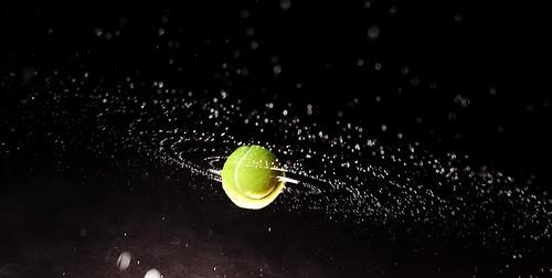 Spinning tennis ball / water