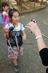 Ready to compare shots with mom - Asakusa, Tokyo, Japan (TravelsWithDan) Tags: girls children cameras photograpers candid streetphotography theotherphotographer showingmom asakusa tokyo japan proud city urban canong3x