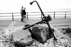 Anchored (Richie Rue) Tags: friends conversation minolta x300 seaside yorkshire northern street promenade walking talking chat 35mm film analogue fomafomapan200 ishootfilm istillshootfilm filmsnotdead