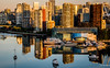 2019 - Vancouver - East False Creek - Sunrise (Ted's photos - For Me & You) Tags: 2019 bc britishcolumbia canada cropped nikon nikond750 nikonfx tedmcgrath tedsphotos vancouver vancouverbc vancouvercity vignetting eastfalsecreek falsecreek water reflection waterreflection boats highrise buildings sunrise